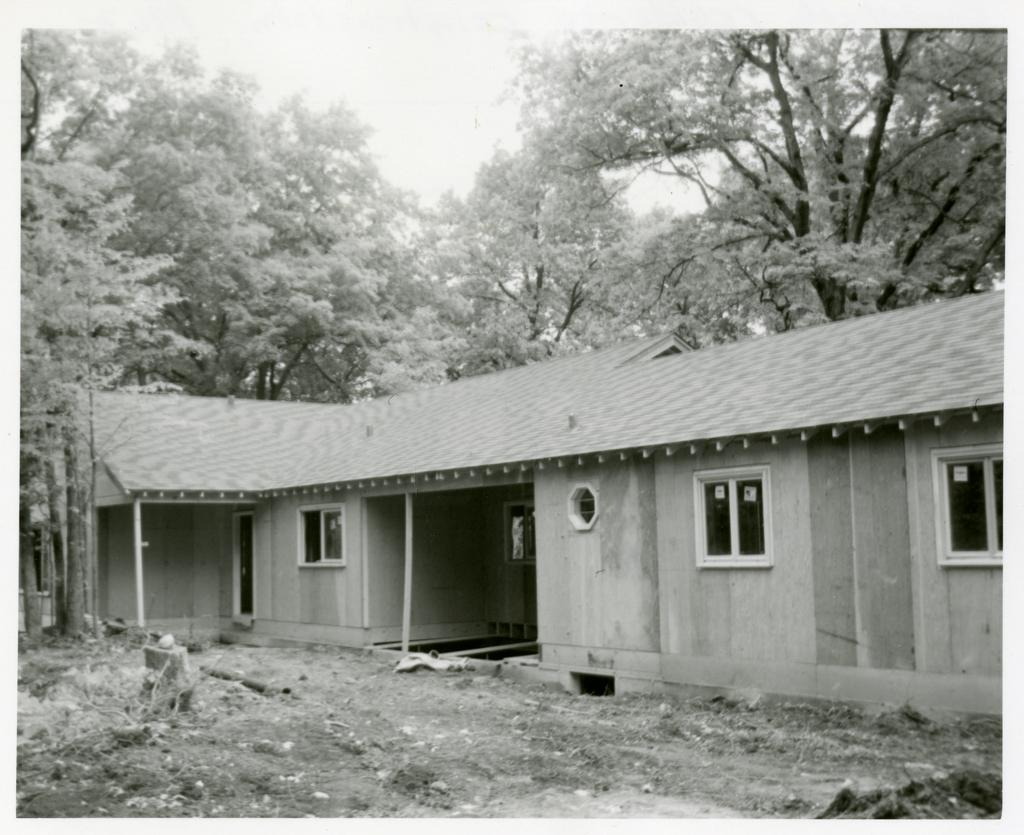 A black and white photographic image of the Clarence Godshalk residence, construction, front exterior