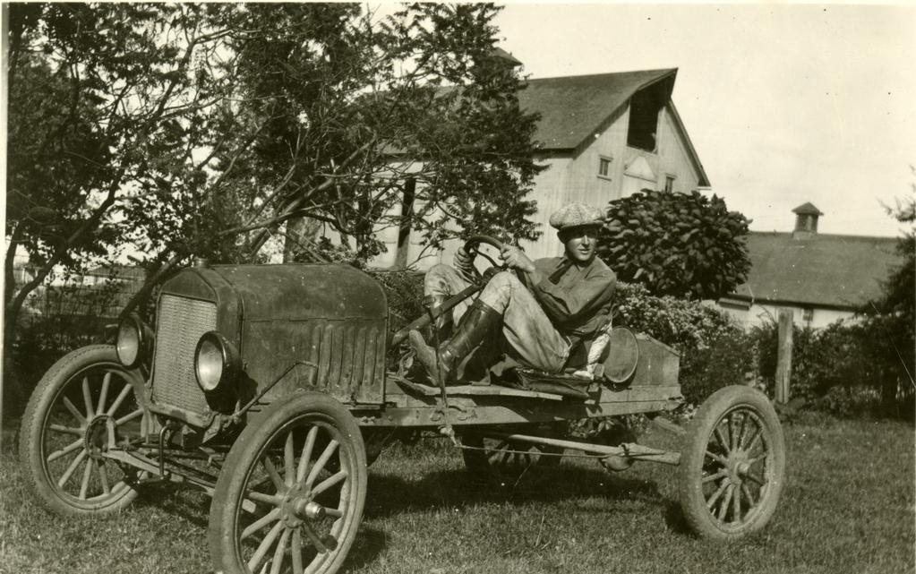 Clarence Godshalk in a runabout made from a Model T car he used to get around the Arboretum grounds.