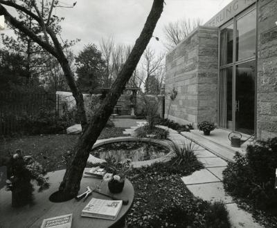 A black and grey photograph of the May T. Watts Reading Garden.
