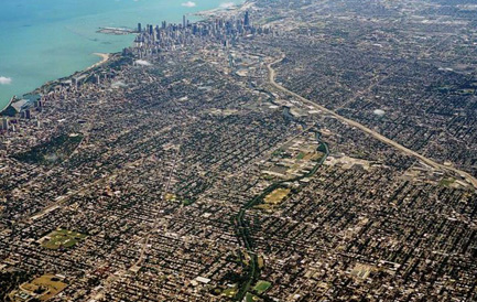 An aerial view of Chicago showing tree canopy among built structures