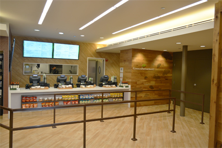 A bank of registers and digital menu boards in Ginkgo Restaurant