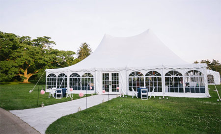 A 4,000-square-foot white tent overlooking the majestic Conifer Collection.