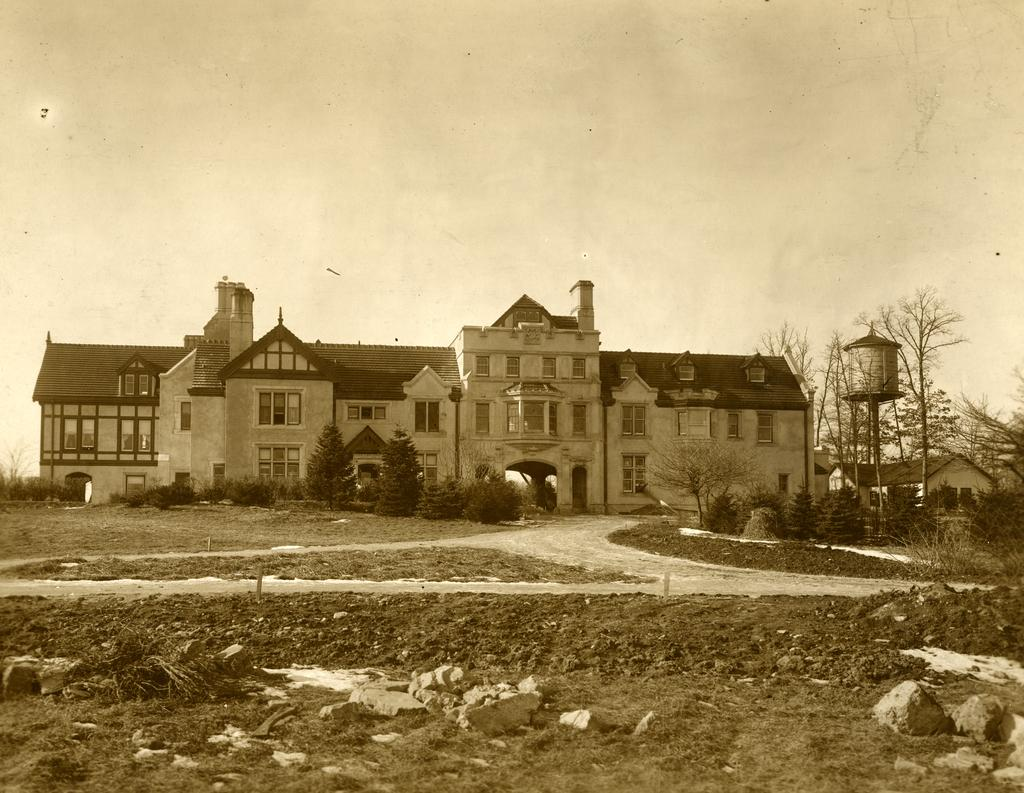 Black and white photograph of the Morton Residence at Thornhill, exterior, front view, just after house was built