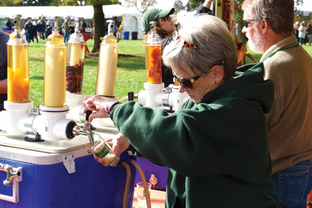 A volunteer pouring samples of ale