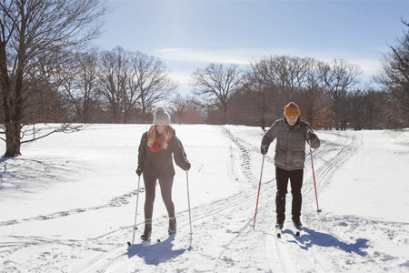 Visitors cross country skiing on a snowy slope