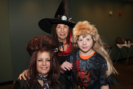 Visitors wearing witch costumes