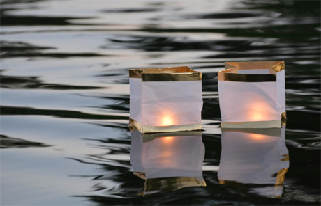 Paper lanterns floating on the water used in a Toro Nagashi ceremony