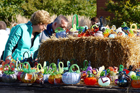 Visitors shopping for hand-blown glass pumpkins