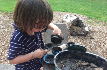 A child making mud pies and dirt cakes