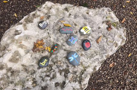 rocks painted with words, letters, and pictures