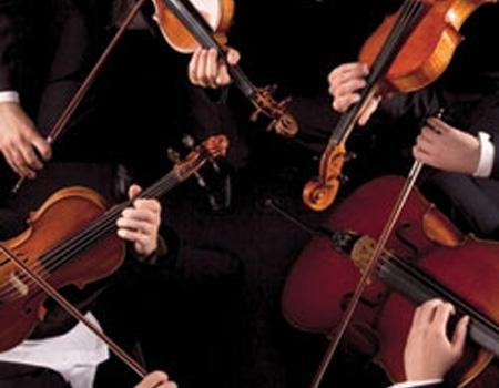 Performers playing violins and violas