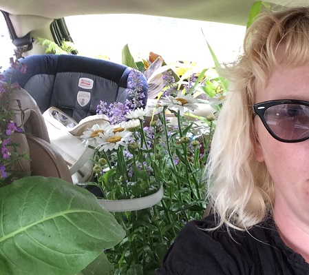 Amanda Thompsen's car overflows with plants, baby seats, and personal belongings