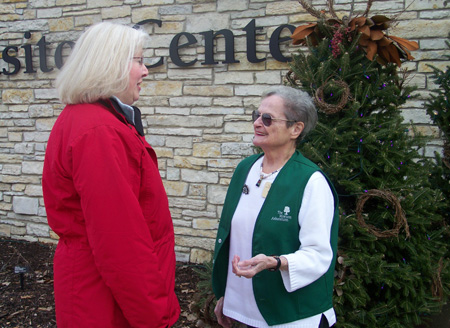 A volunteer speaking to a visitor at The Morton Arboretum